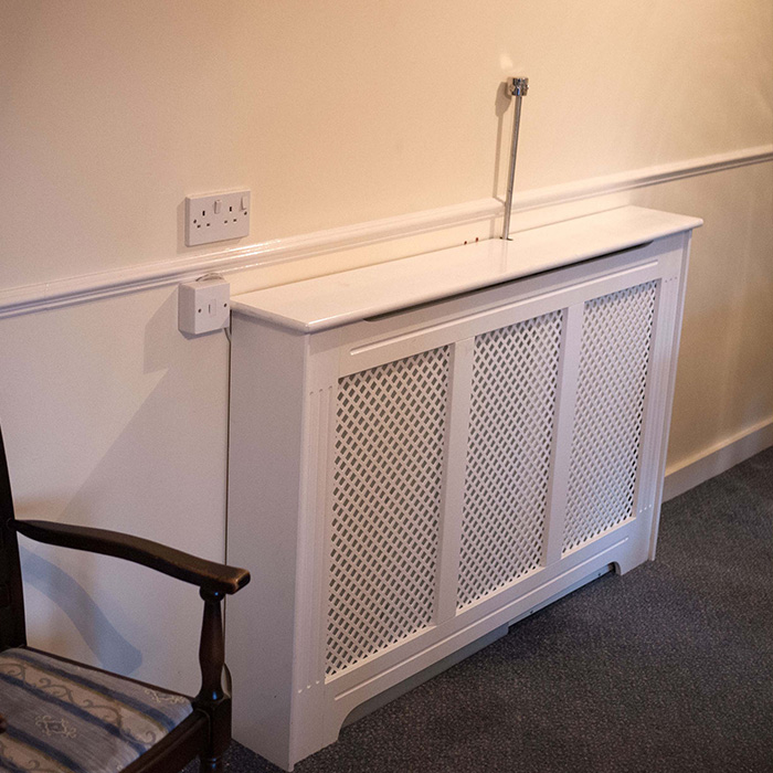 personal protection system behind a radiator cover
